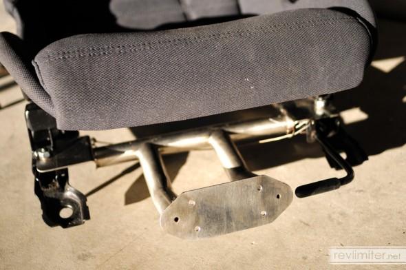 Lotus seat plus Miata extinguisher bracket.