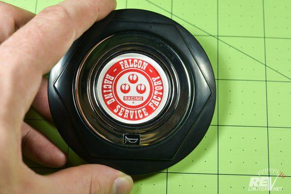 Chrome button inside the trim ring.