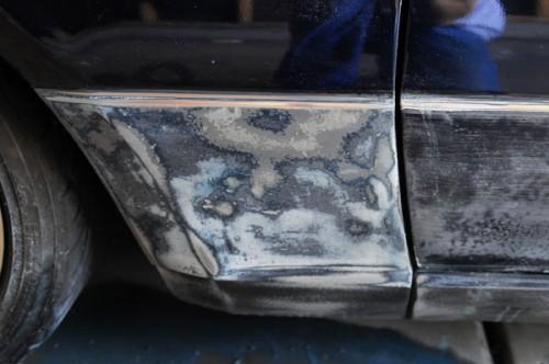 Front quarter panel sanded. More factory montego paint was living under the bad wrinkle coating.