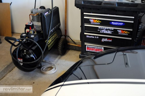 A happy air compressor with a spiffy new drain.