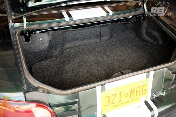 Stock trunk area.