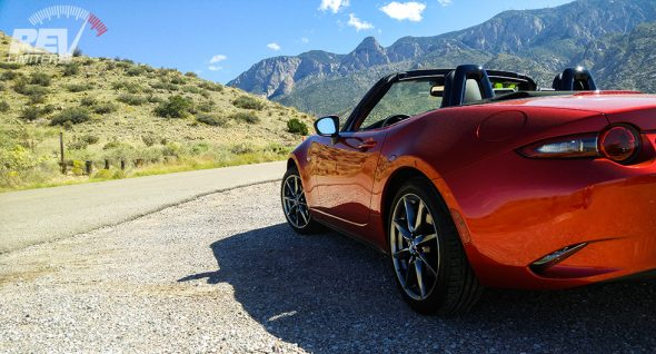 Soul Red. Automatic paddle shifters. Top down. Twisty roads.